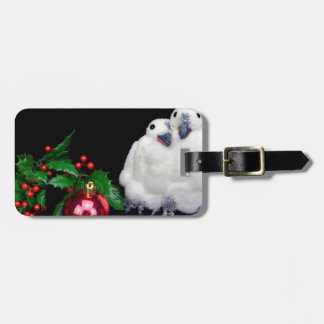 Penguin figurines  with red christmas ball luggage tag