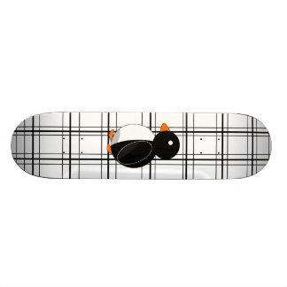 Penguin on black and white plaid skateboard