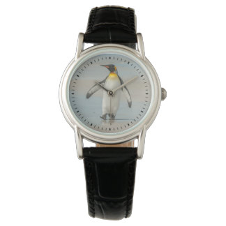 Penguin walking on the beach wristwatch