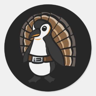Penguin wearing a turkey costume. classic round sticker