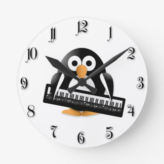 Penguin with piano round clock