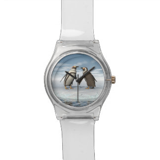 Penguins couple watches