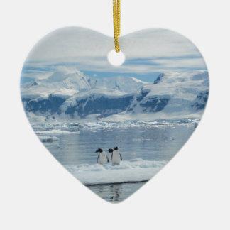 Penguins on an iceberg ceramic ornament