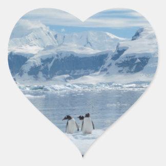 Penguins on an iceberg heart sticker