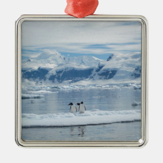 Penguins on an iceberg metal ornament