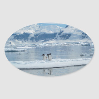 Penguins on an iceberg oval sticker