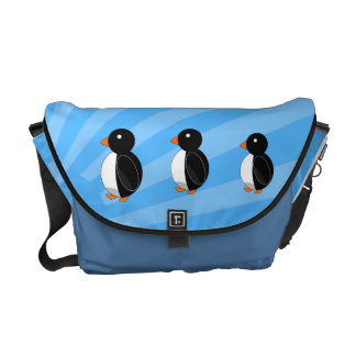 Penguins on blue sunburst messenger bag