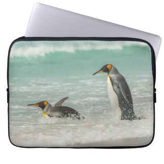 Penguins swimming on the beach laptop sleeve