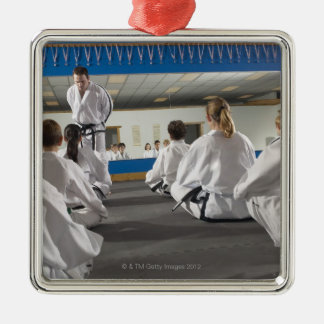 People in a tae kwon do class metal ornament