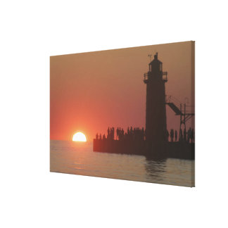 People lighthouse sunset silhouette at South Stretched Canvas Print