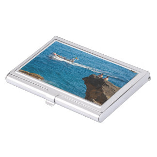 People on an islet business card holder