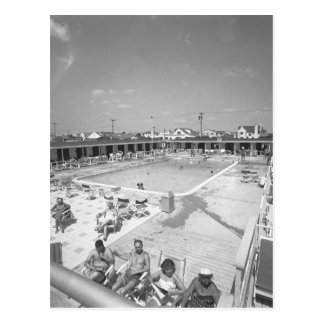 People relaxing at outdoor swimming pool B&W Postcard