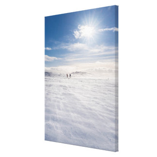 People walking over snow, Iceland Canvas Print