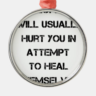people will usually hurt you in attempt to heal Silver-Colored round decoration