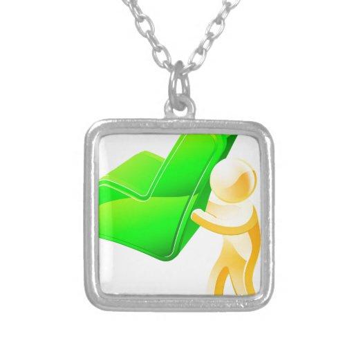 Person holding green tick custom jewelry