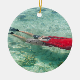 Person snorkeling in clear water ceramic ornament