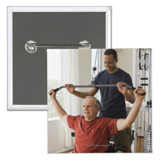 Personal trainer with man in home gym 15 cm square badge