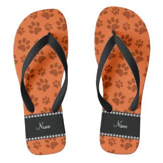 Personalized name orange dog paw print thongs