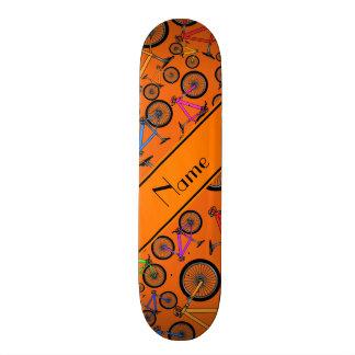 Personalized name orange mountain bikes skate deck