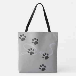 pet paws with a pattern of names on gray tote bag