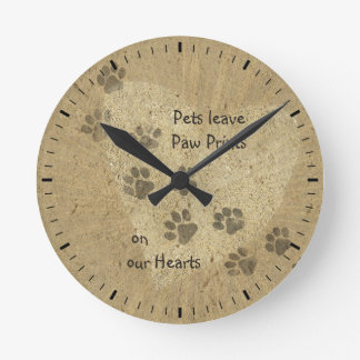 Pets leave Paw Prints on our Hearts Round Clock