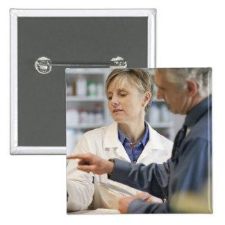 Pharmacist helping customer with medicine 15 cm square badge