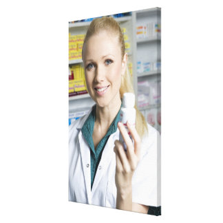 pharmacist holding pill bottle, smiling, gallery wrapped canvas