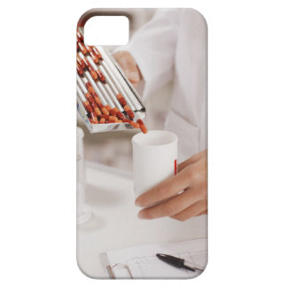 Pharmacist in drug store measuring pills into barely there iPhone 5 case