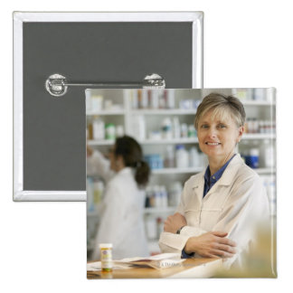Pharmacists at counter of retail pharmacy 15 cm square badge