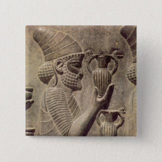 Phoenician carrying two offering, detail relief 15 cm square badge
