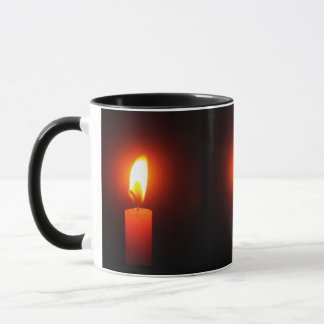 PHOTO OF 3 LIT RED CANDLES ON COFFEE MUG