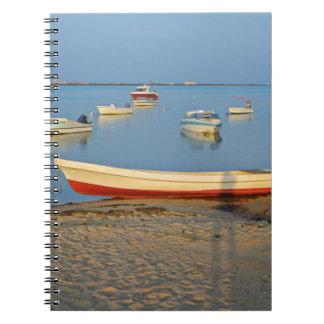 Photo of boats in bay at sunset in Portugal Spiral Notebook