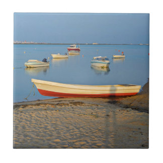 Photo of boats in bay at sunset in Portugal Tile