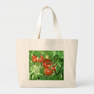 Photo of ripe red tomatoes on the vine tote bags