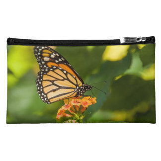 photo small pocket of a butterfly on a flower makeup bag