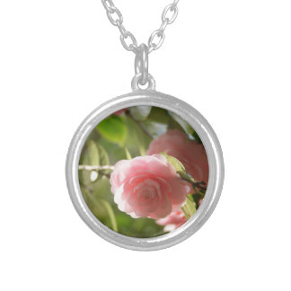 Photograph attachment of flower of faint pink round pendant necklace