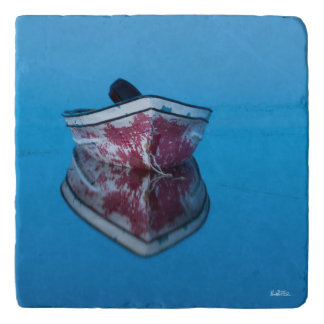 photograph of a boat on water trivet