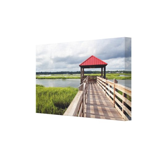 Photograph of a coastal fishing pier in marshland stretched canvas print