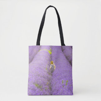 Photograph of a girl walking in a lavender field, tote bag