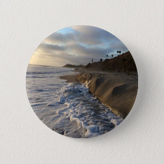 Photograph of the waves hitting the sand 6 cm round badge