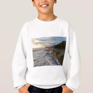 Photograph of the waves hitting the sand sweatshirt