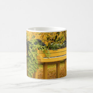 Piano in autumn woods coffee mug