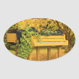Piano in autumn woods oval sticker