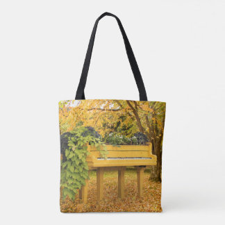 Piano in autumn woods tote bag