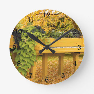 Piano in autumn woods wallclock