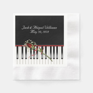 piano keyboard with red rose anniverary paper serviettes