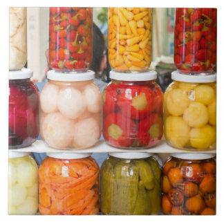 Pickled vegetables in jars large square tile