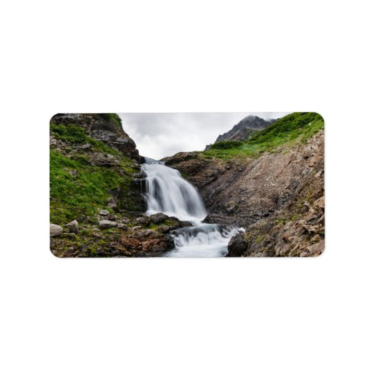 Picturesque waterfall in mountain river address label