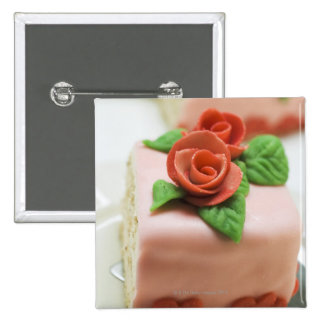 Piece of birthday cake with marzipan roses on button