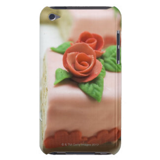 Piece of birthday cake with marzipan roses on barely there iPod case